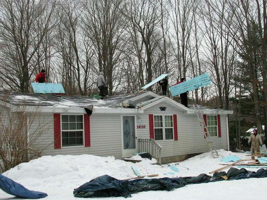 Habitat for Humanity of Benzie County partnered with the Benzie County Department of Veterans Affairs and Bob's Roofing to provide a local veteran with a much needed new roof. (Courtesy photo)