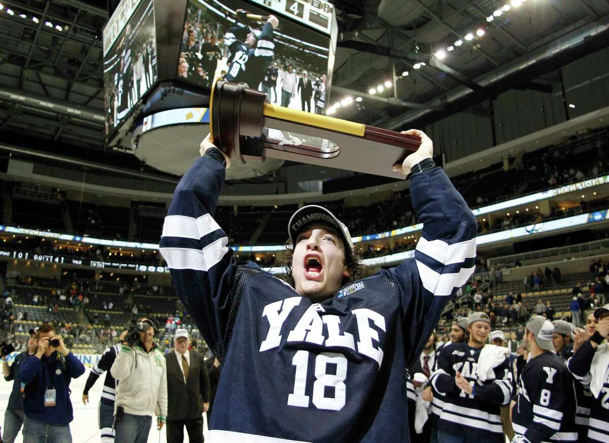 Yale's Kenny Agostino celebrates after defeating Quinnipiac in the National Championship game at Consol Energy Center on April 13, 2013 in Pittsburgh.