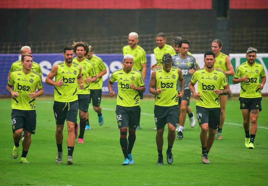 Brazil's Flamengo team players run during a training session in Rio de Janiero, Brazil on December 12, 2019, ahead of the semi-final of the FIFA Club World cup in Doha, Qatar on December 17th. (Photo by CARL DE SOUZA / AFP) (Photo by CARL DE SOUZA/AFP via Getty Images) Photo: CARL DE SOUZA, Contributor / AFP Via Getty Images / AFP or licensors