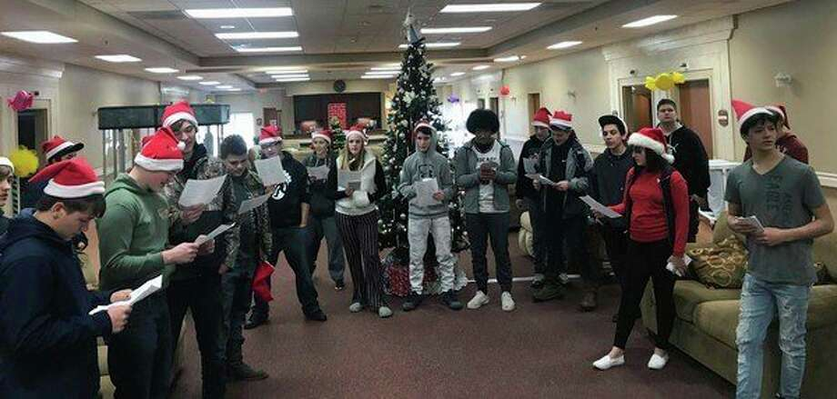 Students from Ascent High School gather to donate a Christmas tree to a family in need during the holiday season. (Courtesy Photo)