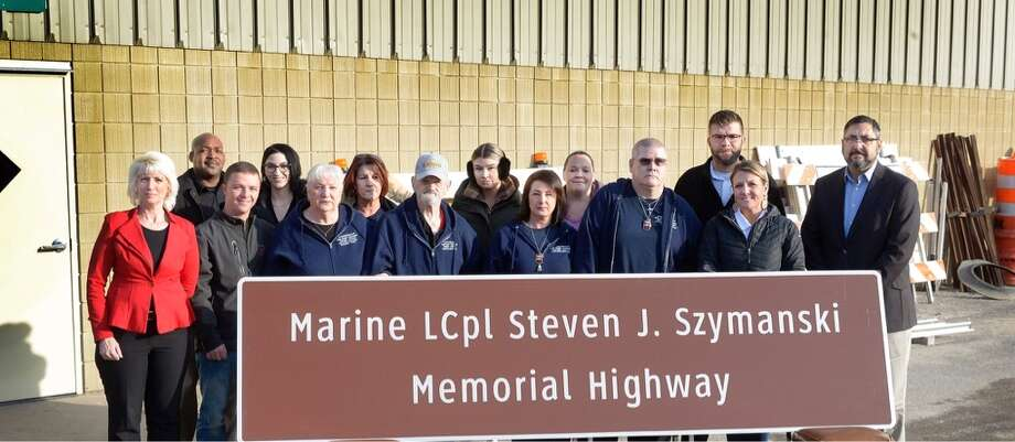 Sen. Jim Stamas, R-Midland, and Rep. Annette Glenn, R-Midland, joined family and friends of Marine Lance Cpl. Steven Szymanski at a ceremony to dedicate a part of U.S. 10 in Midland County as a memorial highway in Szymanski's honor. Szymanski was killed while on duty during a training exercise at Fort Bragg, North Carolina in 2014. (Photo provided) Photo: (Photo Provided)
