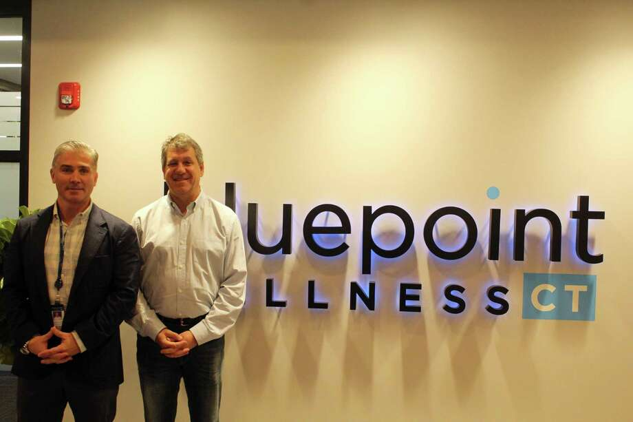 Nick Tamborrino, left, and David Lipton work alongside each other to run Bluepoint Wellness Dispensary based in Westport. Taken Dec. 23, 2019 in Westport, Conn. Photo: DJ Simmons/Hearst Connecticut Media