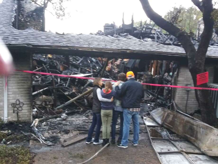 After a local family lost their home and two dogs in a fire last week, neighbors and the surrounding community stepped in and raised more than $15,000 to help them during Christmastime. Photo: Provided By Aric J. Garza