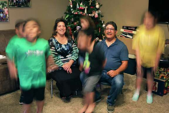 Frank Bryand, right, and Elizabeth Bryand, left, have been foster parents to more than 600 children over the past decades. All have come from Texas Child Protective Services. The faces of the children with the couple are blurred in accordance with CPS' privacy and confidentiality rules.