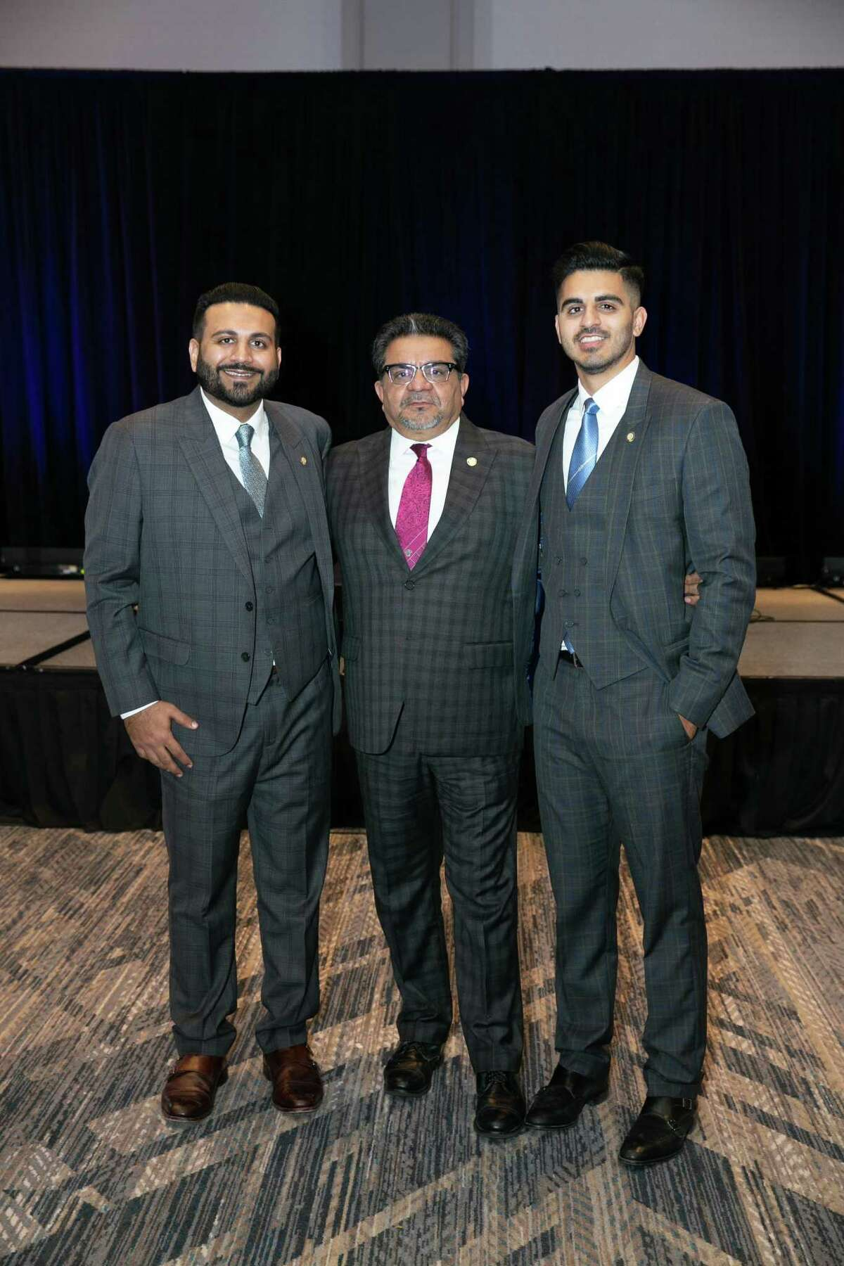 Shoukat Dhanani, CEO of the Dhanani Group, stands between his sons Zohaib to the left and Usman to his right. Their Sugar Land-headquartered firm that owns1,100 restaurants, 125 convenience stores, two multifamily developments and a wholesale fuel distributor. The company generates more than $2 billion in annual revenue.