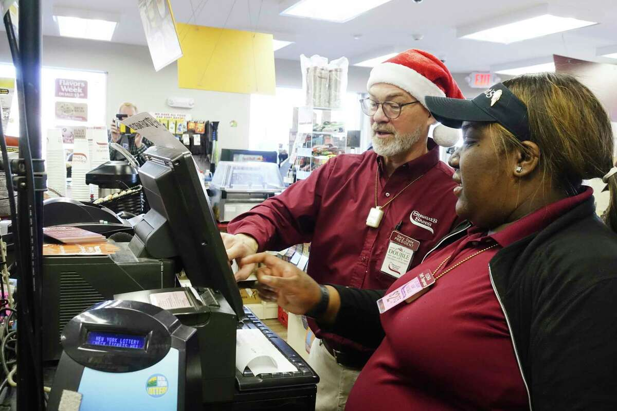 Stewart's Shops President Gary Dake, left, and employee, I'Leika Murphy, checkout a customer at the Arbor Hill Stewart's Shop on Tuesday, Dec. 24, 2019, in Albany, N.Y. Dake came to the shop to work the register and to personally thank customers for their generosity for the company's Holiday Match program. The shop, located on Henry Johnson Boulevard, had the highest growth in the first half of the Holiday Match season, with a 244% growth over last year. All the funds raised through the program go to support local children's organizations. (Paul Buckowski/Times Union)