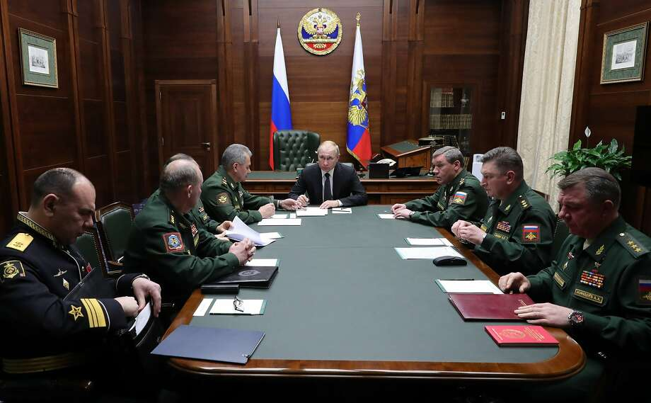 President Vladimir Putin (center) leads a meeting with top military officers in the National Defense Control Center in Moscow. He says Russia has developed an entire new class of weapons. Photo: Mikhail Klimentyev / Associated Press