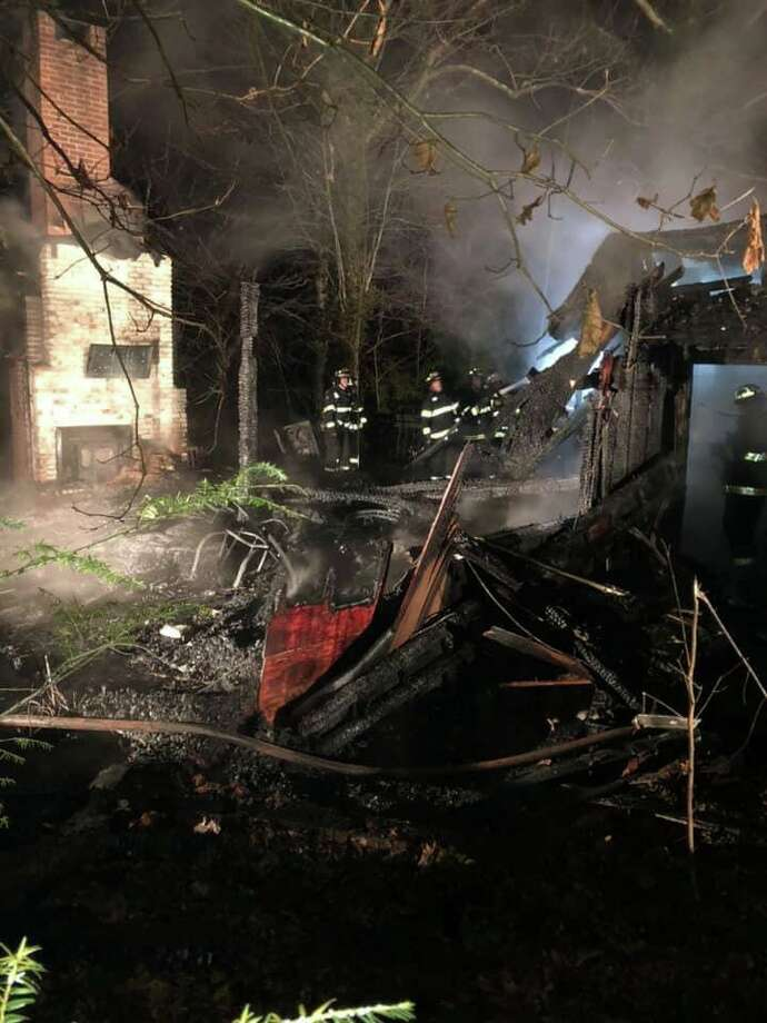 Six tanker trucks and five engines from three fire companies put out a house fire in New Milford Saturday, Dec. 21. Friends and neighbors have begun organizing a fundraising campaign to help the middle-aged couple displaced by the fire. Photo: Contributed / Water Witch Hose Co. No. 2 Of New Milford