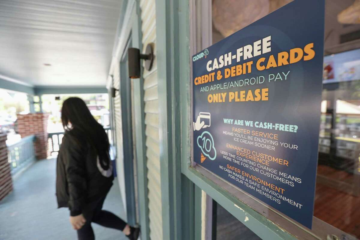 A sign informs customers that Cloud 10 Creamery in Houston is a cash-free establishment. Many businesses find cards and electronic payments more efficient and safer.
