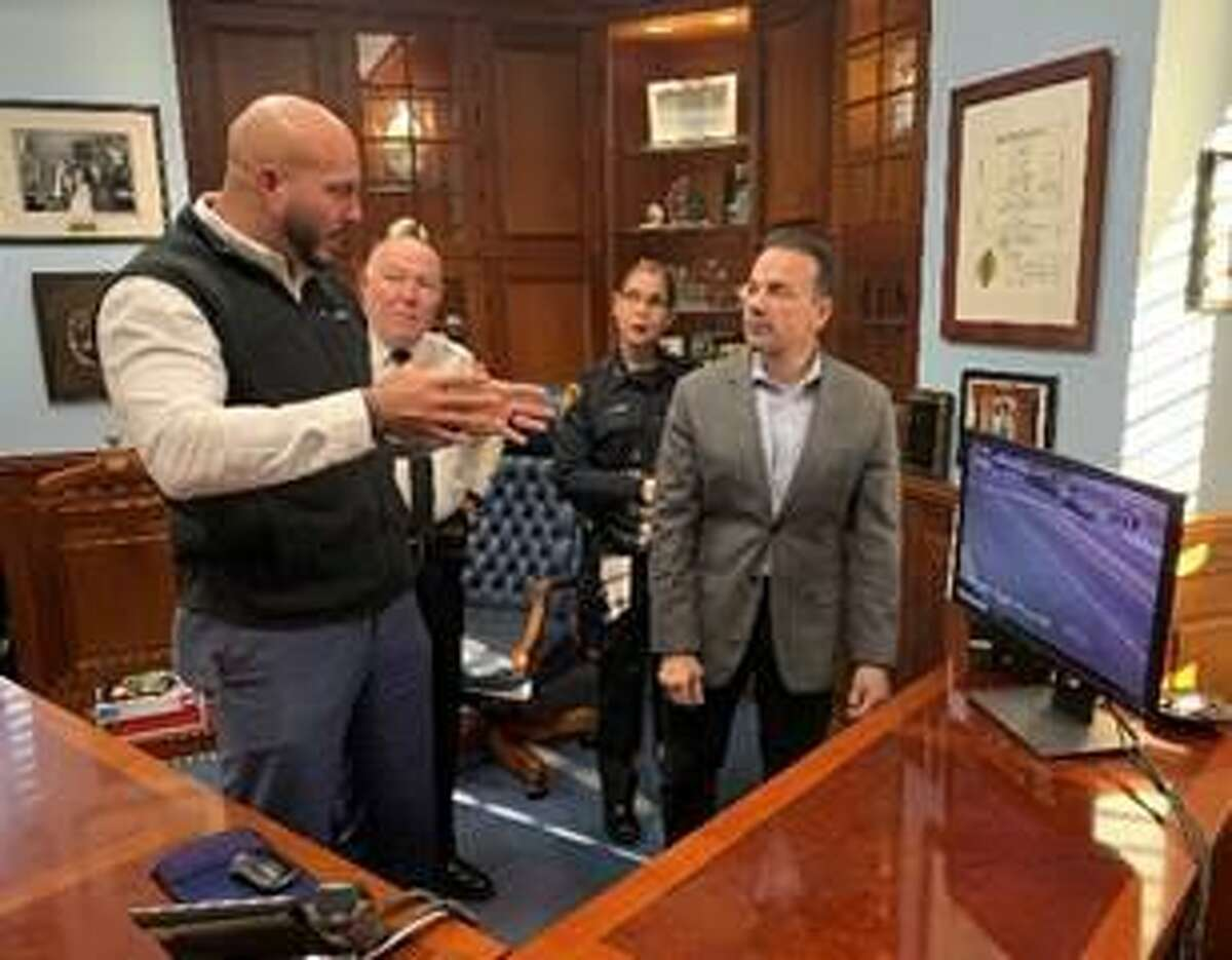 Officer Carlos Carmo Jr. meets with Mayor Joseph Ganim, Police Chief A.J. Perez and Assistant Chief Rebeca Garcia. Dec. 23, 2019