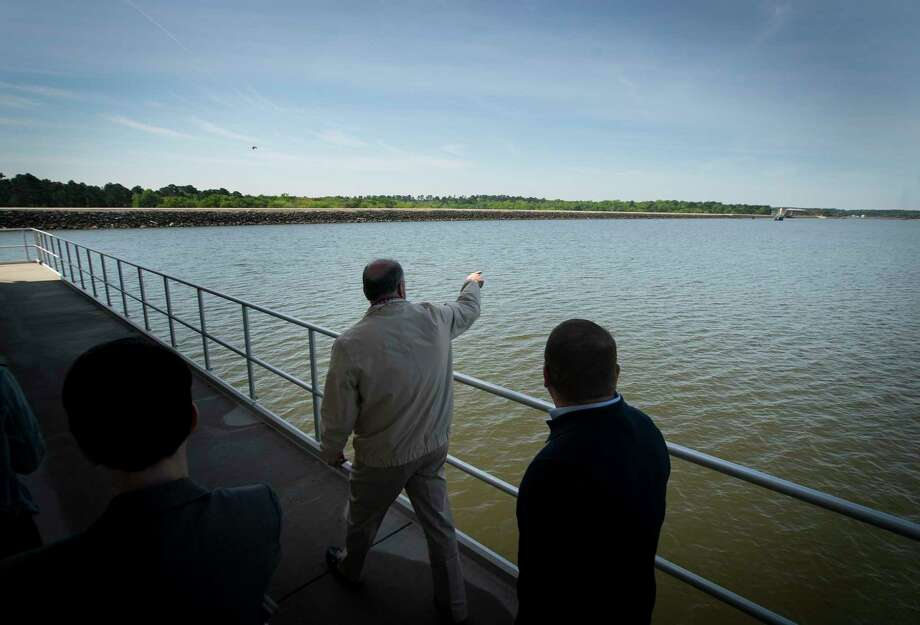 Groundwater reduction plan administrator Mark Smith leads a tour of the raw water intake and pump station building that juts into Lake Conroe from the dam that creates the lake at the San Jacinto River Authority's surface water treatment plant, Tuesday, April 2, 2019. Photo: Mark Mulligan, Houston Chronicle / Staff Photographer / © 2019 Mark Mulligan / Houston Chronicle