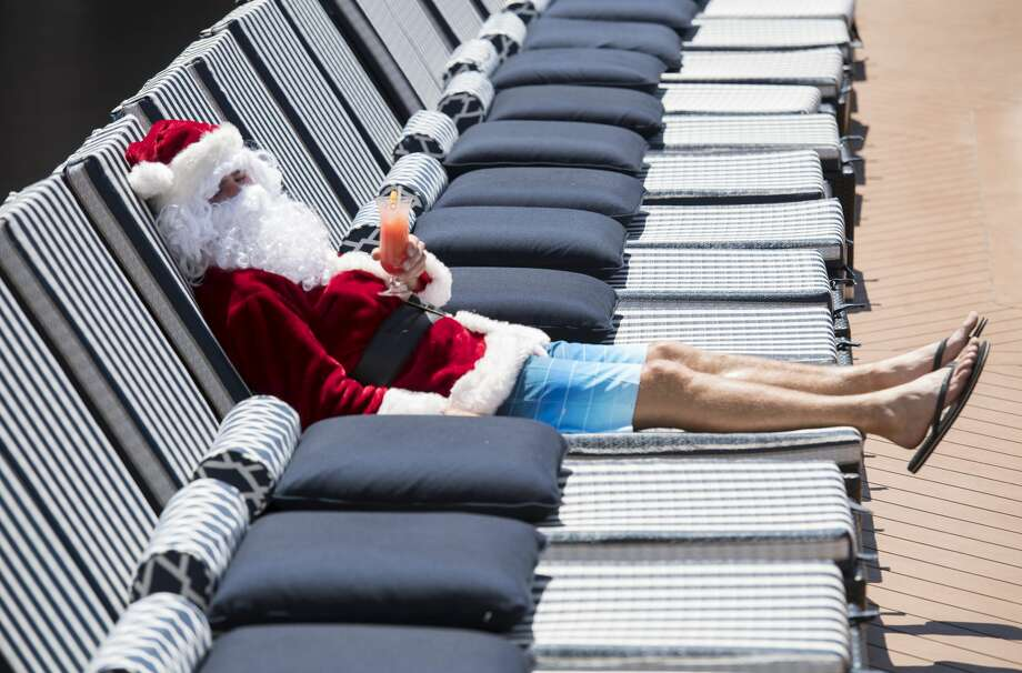 Santa will have to put on his shorts to visit San Antonio, as temperatures are expected to reach the 70s for Christmas. Photo: James D. Morgan/Getty Images For P&O Cruises Aus