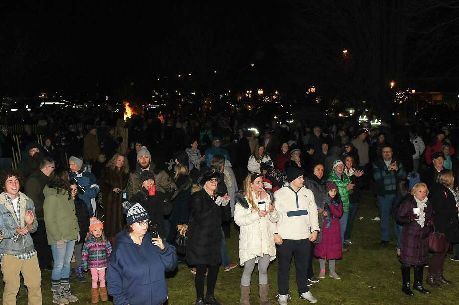 The crowd  at last year's First Annual Branford First Night Celebration, with the bonfire in the background. Photo: Contributed / Bill O'Brien