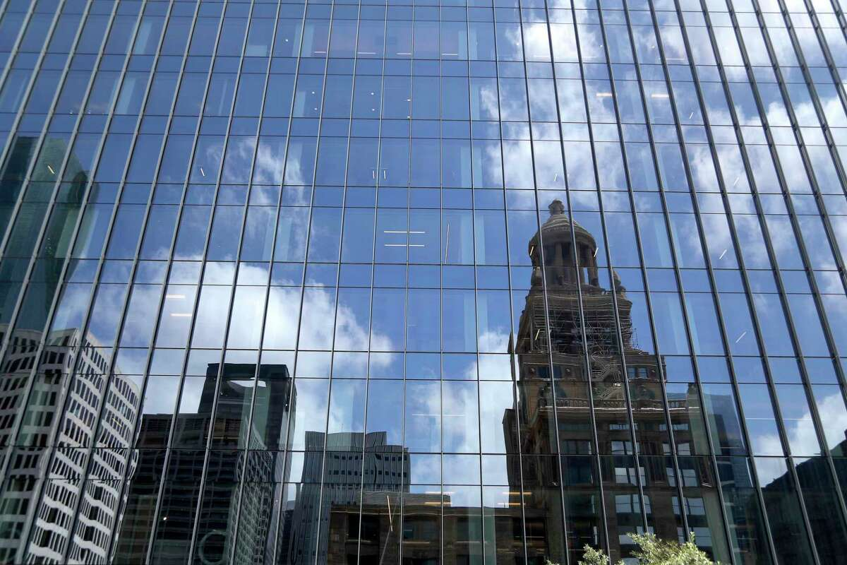 The Bank of America Tower, Wednesday, May 22, 2019, with the Esperson Building reflected in the windows. The Bank of America Tower, a 35-story office building and a development of Skanska in downtown, has been under construction for the last two years at 800 Capitol St.