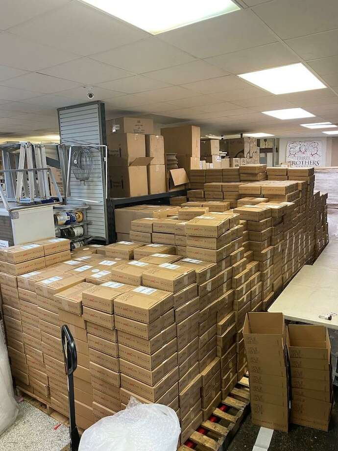 Three Brothers Bakery is hoping to sell 25,000 to 50,000 pecan pies to help survive the COVID-19 pandemic. Here, its crew set their all-time record in December 2019, shipping out about 4,000 pies in just two days. Photo: Courtesy By Three Brothers Bakery