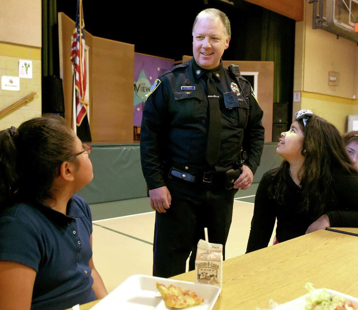 In this file photo, East Haven Police officer Dave Torello, DARE program officer, with Tuttle School fourth graders during lunch in East Haven in 2015.