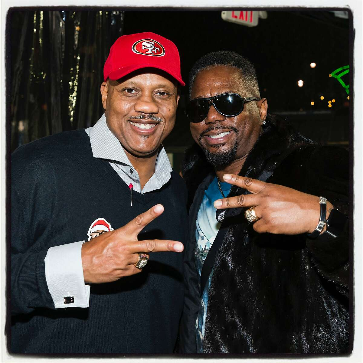 Holiday Heroes honoree Dennis Brown (left) with his former 49ers teammate Ricky Watters. Dec. 10, 2019.