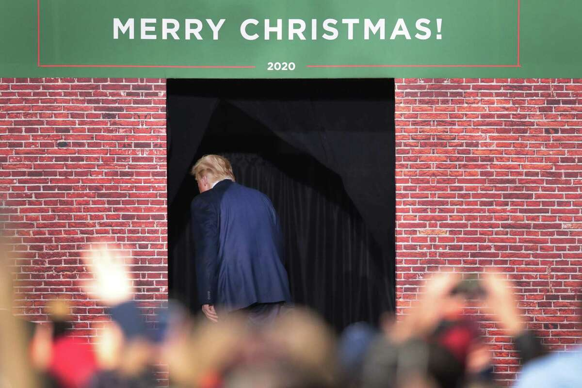 BATTLE CREEK, MICHIGAN - DECEMBER 18: President Donald Trump leaves his Merry Christmas Rally at the Kellogg Arena on December 18, 2019 in Battle Creek, Michigan. While Trump spoke at the rally the House of Representatives voted, mostly along party lines, to impeach the president for abuse of power and obstruction of Congress, making him just the third president in U.S. history to be impeached. (Photo by Scott Olson/Getty Images) *** BESTPIX ***