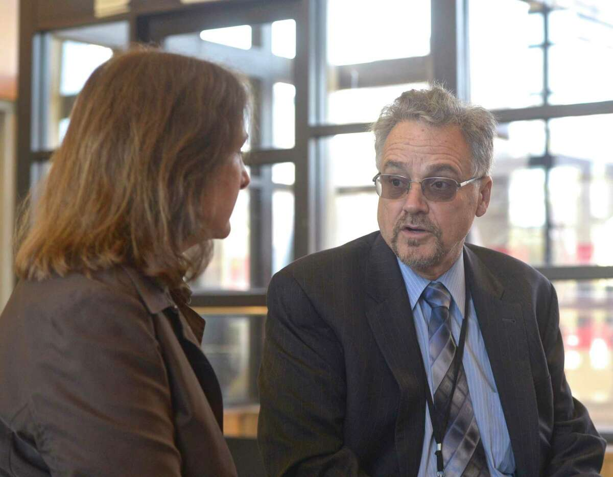 Connecticut Department of Transportation Commissioner Joseph Giulietti, right, and MTA Metro-North Railroad President Catherine Rinaldi talk in the Danbury Train Station before taking the train to South Norwalk on Thursday, April 25, 2019, Danbury, Conn.