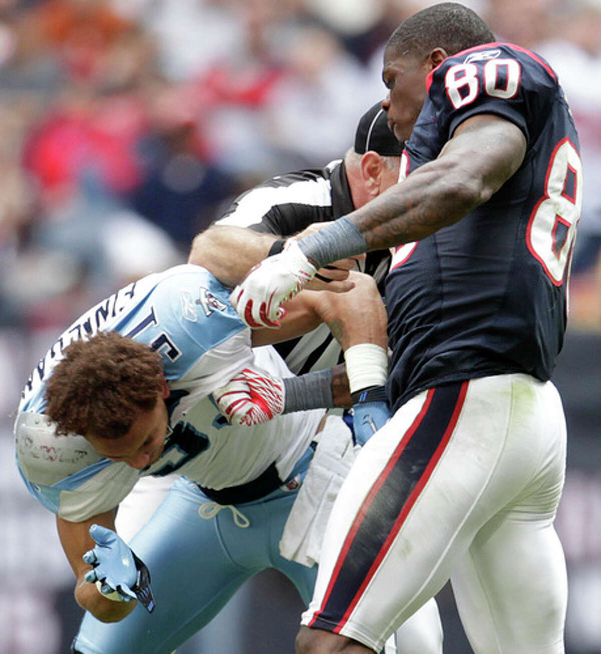 Nov. 28, 2010: Houston Texans wide receiver Andre Johnson (80) and Tennessee Titans cornerback Cortland Finnegan (31) get into a fist fight during the fourth quarter and both were ejected of the Houston Texans-Tennessee Titans NFL football game at Reliant Stadium in Houston.