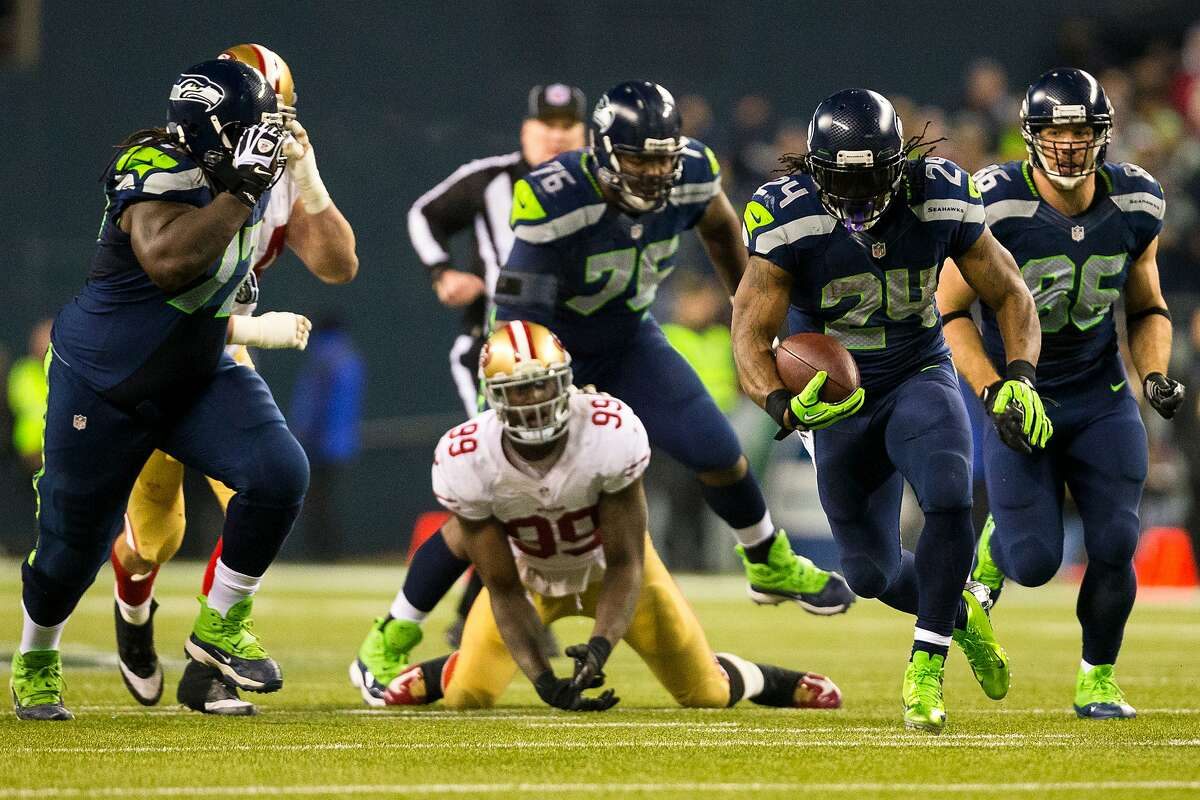 Seahawks running back Marshawn Lynch, right, pushes through 49ers defense during the first half of the NFC Championship game Sunday, Jan. 19, 2014, at CenturyLink Field in Seattle. (Jordan Stead, seattlepi.com)