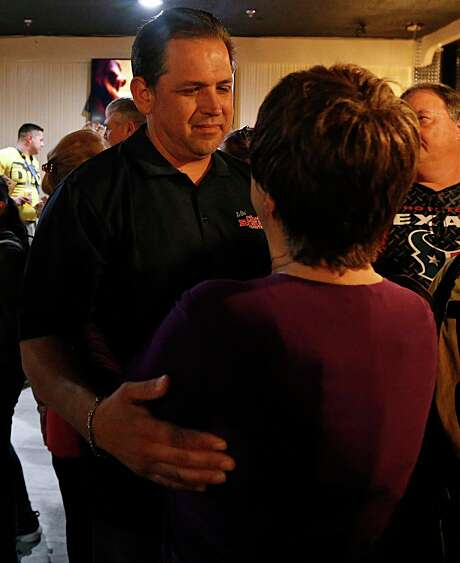 Harris County Precinct 2 Constable Chris Diaz left, thanks a supporter during his election night watch party at the Quality Inn hotel on March 1, 2016, in Houston. Diaz is trailing challenger Jerry Garica and looks headed for a runoff in 2020. Photo: James Nielsen, Staff / Houston Chronicle / © 2016  Houston Chronicle