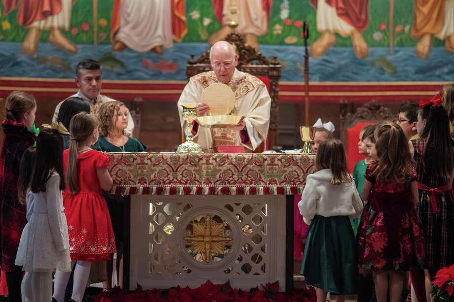 A Christmas Eve Family Vigil Mass was held at St. Anthony Cathedral Basilica on Tuesday, December 24, 2019. The children were invited to join Monsignor Jerry McGrath at the altar during the consecration of the gifts. Fran Ruchalski/The Enterprise Photo: Fran Ruchalski/The Enterprise