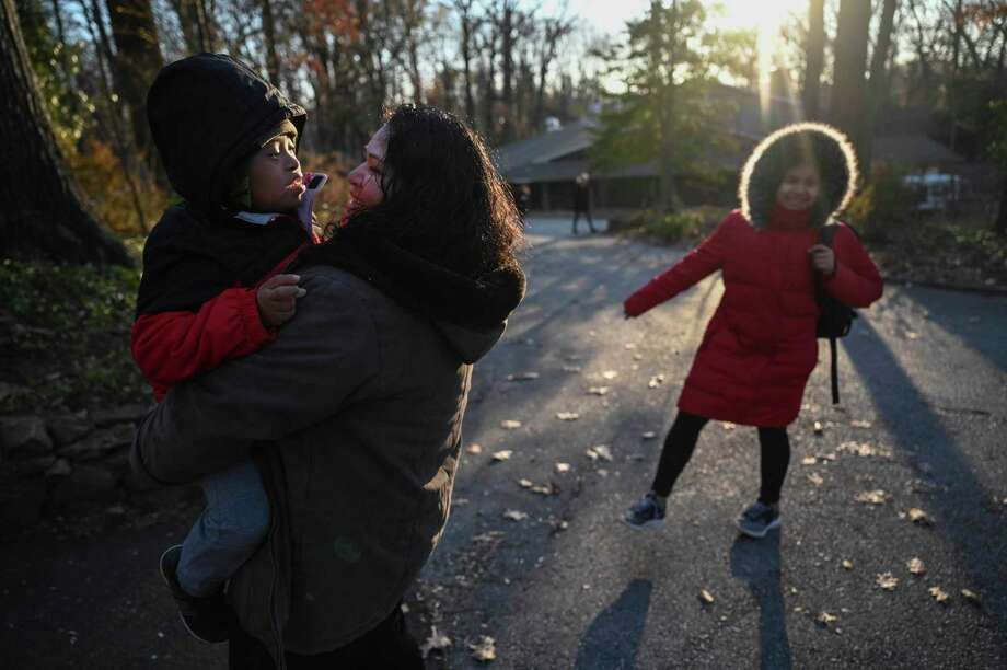 Rosa Gutierez greets her children, John Tojin Gutierrez, 7, left and Maria Salome Guitierrez, after they arrive home at Cedar Lane Unitarian Universalist Church, where they have been seeking sanctuary for the past year. Gutierrez fled to the Bethesda, Maryland, church when she feared she would be deported and separated from her children. Photo: Washington Post Photo By Michael Robinson Chavez / The Washington Post