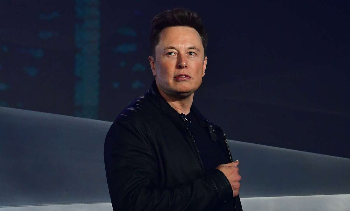 (FILES) In this file photo taken on November 21, 2019 Tesla co-founder and CEO Elon Musk introduces the newly unveiled all-electric battery-powered Tesla Cybertruck at Tesla Design Center in Hawthorne, California. - Tesla co-founder Elon Musk went on trial on Tuesday in Los Angeles in a defamation case involving a British caver he allegedly called a pedophile during a spat on Twitter. A jury of six women and two men were selected to hear the case with the tech billionnaire set to testify early on in the trial, possibly Tuesday afternoon. (Photo by Frederic J. BROWN / AFP) (Photo by FREDERIC J. BROWN/AFP via Getty Images)