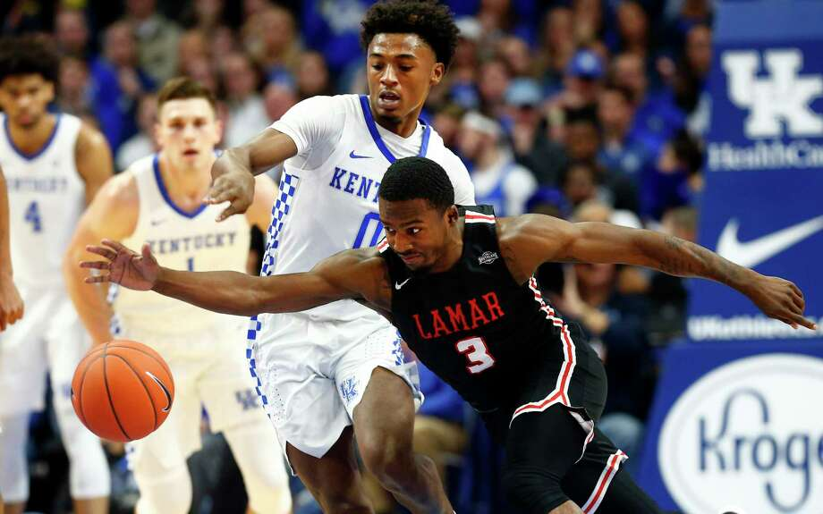 Lamar's Ellis Jefferson (3) struggles with the ball while pressured by Kentucky's Ashton Hagans (0) during the first half of an NCAA college basketball game in Lexington, Ky., Sunday, Nov. 24, 2019. (AP Photo/James Crisp) Photo: James Crisp / James Crisp/Associated Press / Copyright 2019 The Associated Press. All rights reserved.
