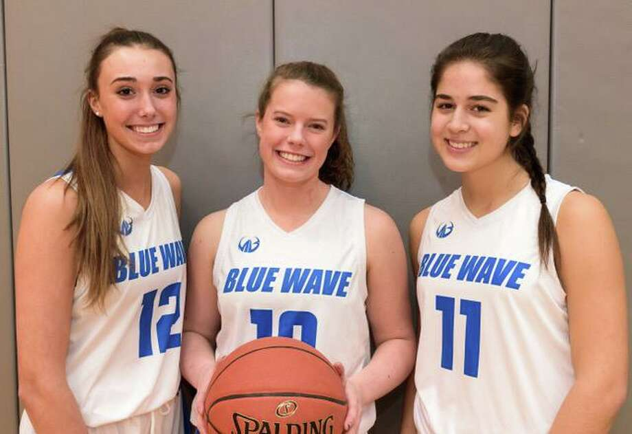 Darien girls basketball captains, from left, Lindsay Dimonekas, Gwen Dolce and Kelly Richter, have helped the Blue Wave start the season with a sweep of three games in the first week of the season. Photo: Jim Smith / Contributed