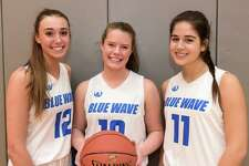 Darien girls basketball captains, from left, Lindsay Dimonekas, Gwen Dolce and Kelly Richter, have helped the Blue Wave start the season with a sweep of three games in the first week of the season.
