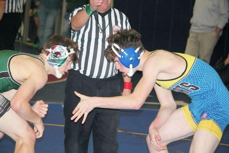 Evart's Josiah Beard (right) gets set to work against Connor Hess of Battle Creek Pennfield in a 145-pound match at Saturday'sChippewa Hills Joe Loren Invitational. (Herald Review photo/John Raffel)