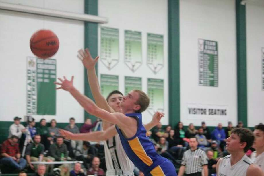 Evart's Cam Brasington goes to the basket against Pine River on Thursday. (Herald Review photo/John Raffel)