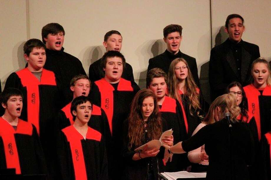"Choir members are joined by alumni to sing the concert finale ""Sleigh Ride."" (Photo/Robert Myers)"