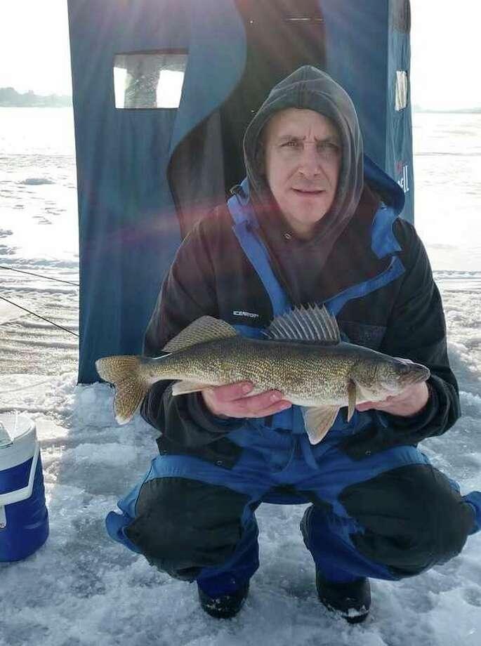 Evart's Paul Higgins is looking forward to the upcoming ice fishing season. (Courtesy photo)