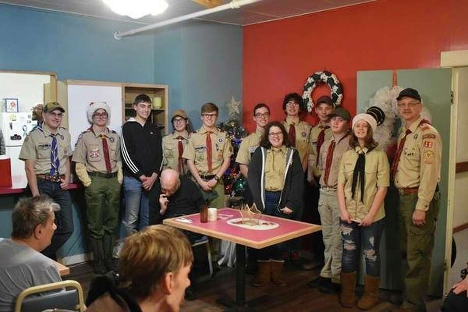 Local Scouts help share the holiday spirit at Crystal View Adult Foster Care. (Courtesy photo/Shane Iverson)
