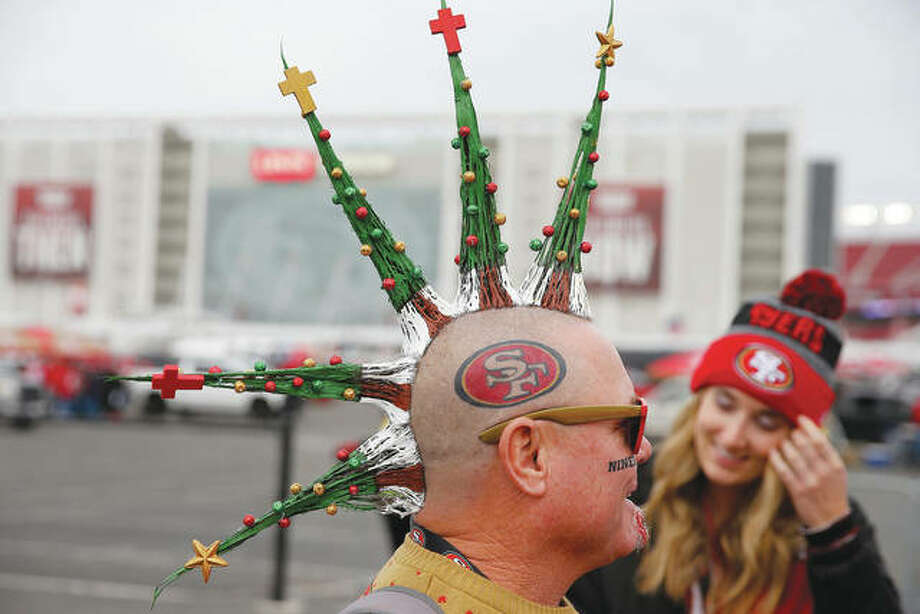 A fan gets into the holiday spirit while tailgating before an NFL football game between the San Francisco 49ers and the Los Angeles Rams.