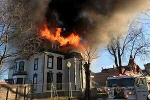 A building at 1303 Chapel St. goes up in flames on Wednesday, Christmas morning.