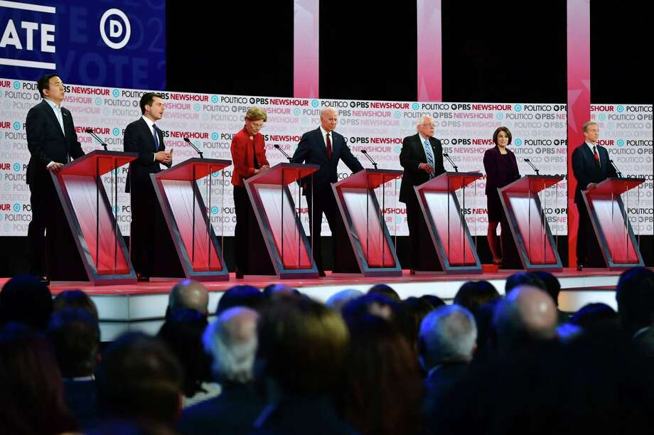 Democratic presidential hopefuls, from left, entrepreneur Andrew Yang, Mayor of South Bend, Ind., Pete Buttigieg, Massachusetts Sen. Elizabeth Warren, former Vice President Joe Biden, Vermont Sen. Bernie Sanders, Minnesota Sen. Amy Klobuchar and businessman Tom Steyer participate of the sixth Democratic primary debate of the 2020 presidential campaign season co-hosted by PBS NewsHour & Politico at Loyola Marymount University in Los Angeles, California on Dec. 19. Photo: Frederic J. Brown / AFP Via Getty Images / AFP or licensors