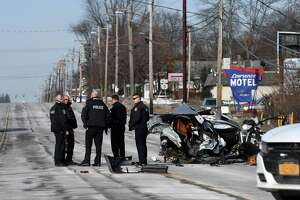 Colonie Police respond to the scene of fatal car crash near Lombard Street on Central Avenue on Wednesday morning, Dec. 25, 2019, in Colonie, N.Y. A silver Audi sedan was split in half after hitting a utility pole. One person was killed and three others are in critical condition, according to Colonie Police. (Will Waldron/Times Union)
