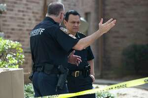 Harris County Sheriff Ed Gonzalez receives information from officers at the scene where a 15-year-old boy shot his 17-year-old girlfriend in the leg at an apartment complex on the 300 block of Parrametta Lane on Wednesday, Dec. 25, 2019, in Houston. It was unclear whether it was accidental or intentional, Gonzalez said. The victim was taken to the hospital and in stable condition.