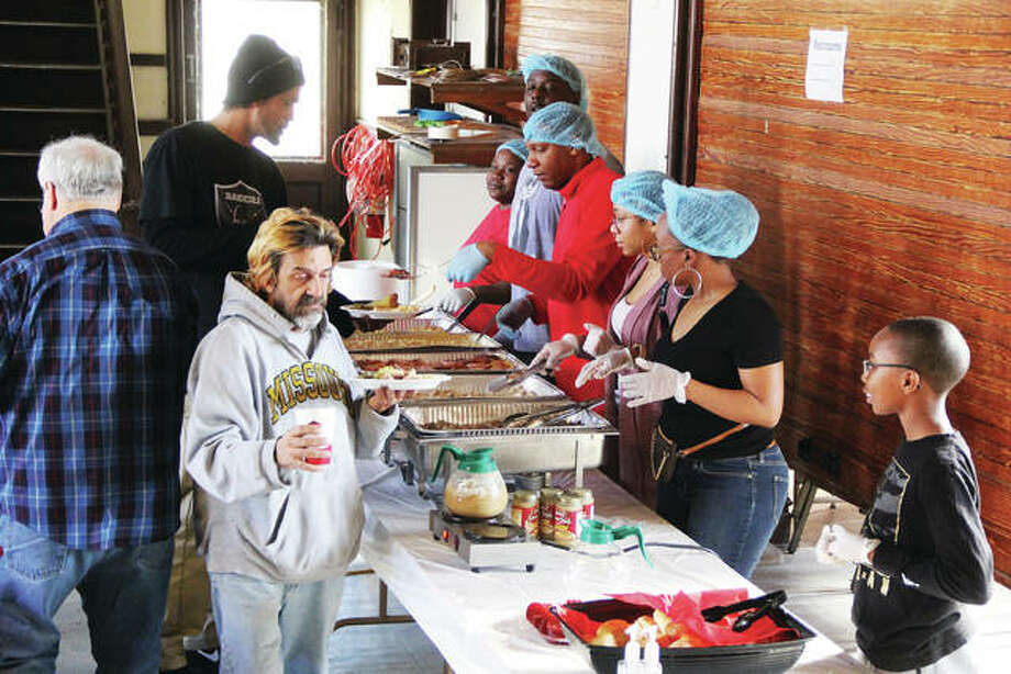 People work their way through the serving line at a free Christmas dinner Wednesday at the St. John Missionary Baptist Church on Market Street in Alton. The church has been providing Christmas dinner since 2013 and was expected to serve about 80 people between 11 a.m. and 2 p.m.