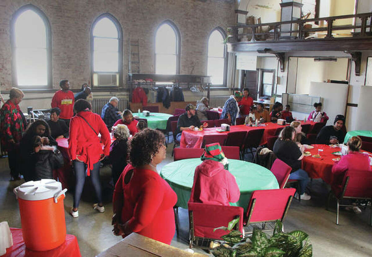 People talk and eat during a free Christmas dinner Wednesday at the St. John Missionary Baptist Church on Market Street in Alton. The church has been providing Christmas dinner since 2013, and was expected to serve approximately 80 people between 11 a.m. and 2 p.m.