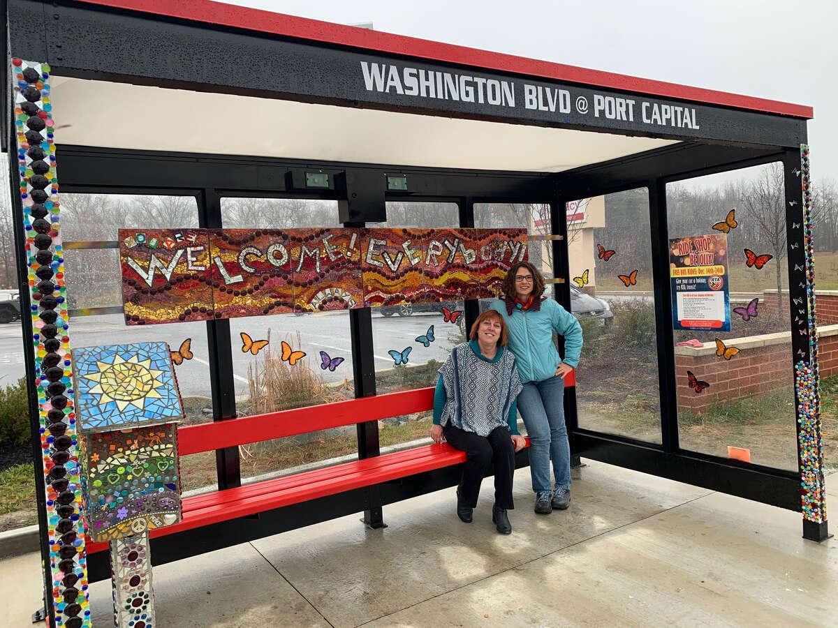 Baltimore artist Eileen Gillan, left, and Elkridge resident Erin Cassell visit a new artistic bus shelter that they designed on Route 1 in Elkridge, Md.