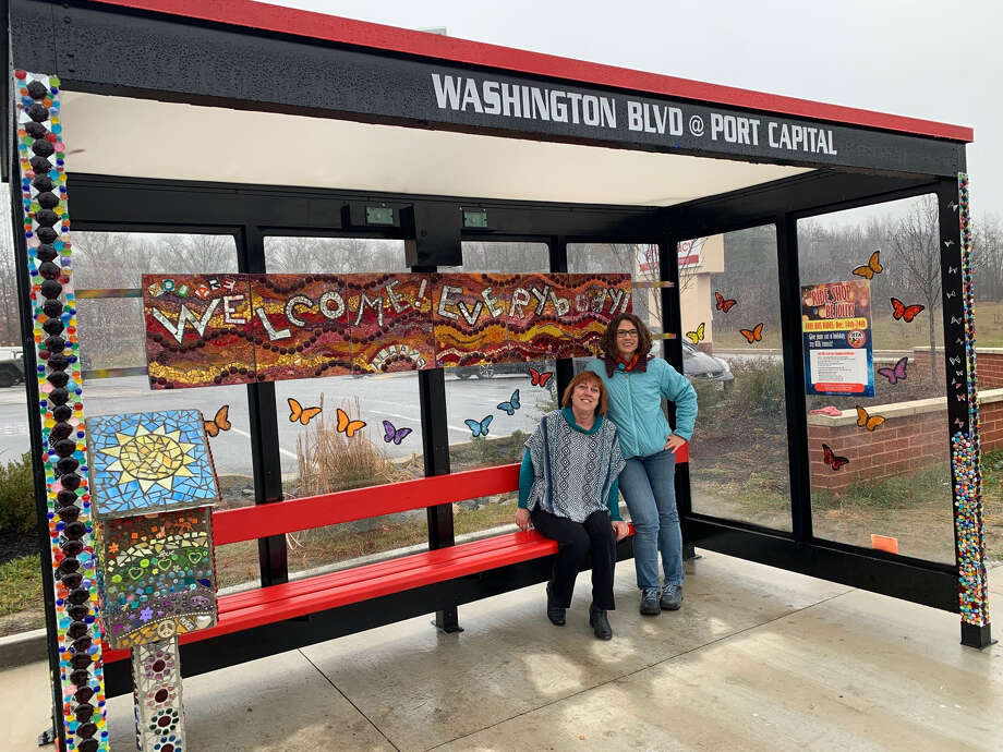 Baltimore artist Eileen Gillan, left, and Elkridge resident Erin Cassell visit a new artistic bus shelter that they designed on Route 1 in Elkridge, Md. Photo: Washington Post Photo By Katherine Shaver / The Washington Post