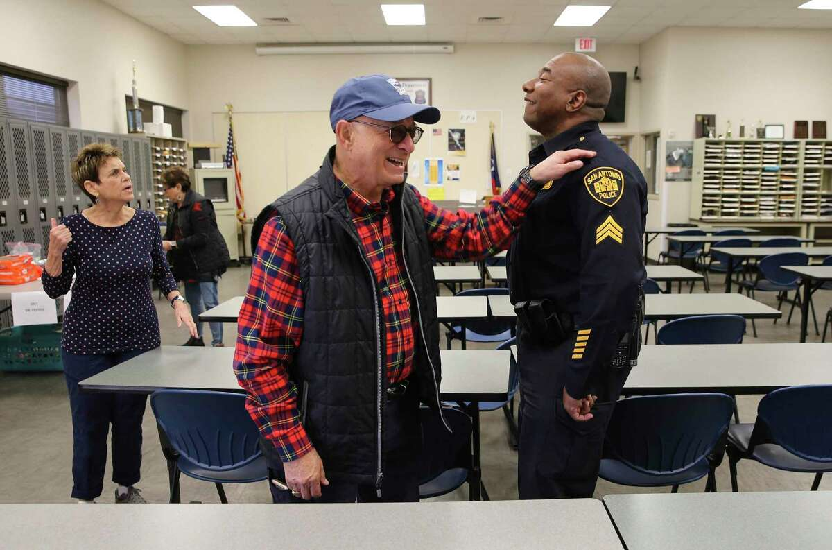 Jerry Gerson (left) offers his appreciation for San Antonio Police Sgt. Malcolm Guidry after Gerson and several volunteers drop off meals for police officers at the Southeast Substation off Houston Street. Members of the Jewish congregation of Temple Beth-El provided meals Wednesday to first responders who had to work on Christmas Day at 55 police and fire stations across Bexar County.