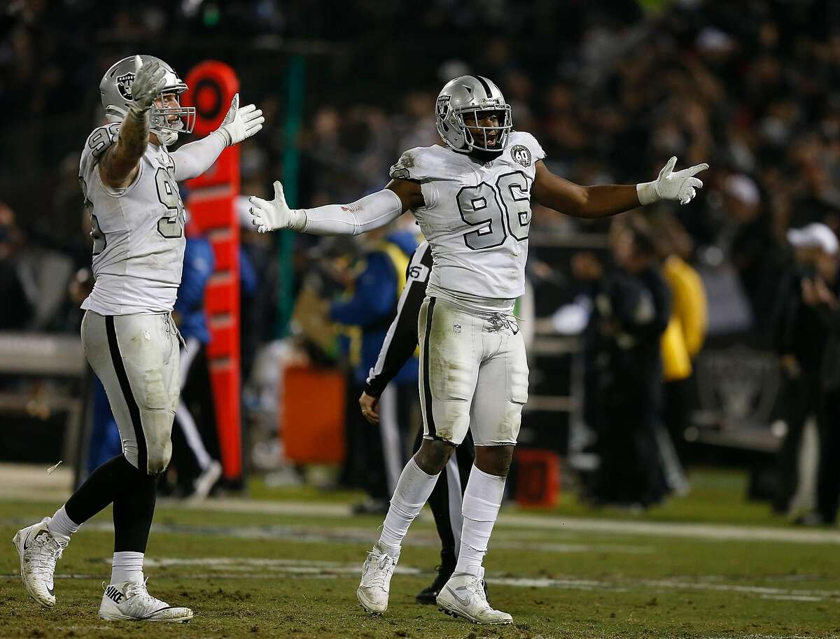 OAKLAND, CALIFORNIA - NOVEMBER 07: Maxx Crosby #98 and Clelin Ferrell #96 of the Oakland Raiders celebrate after an interception was thrown by Philip Rivers #17 of the Los Angeles Chargers late in the fourth quarter at RingCentral Coliseum on November 07,