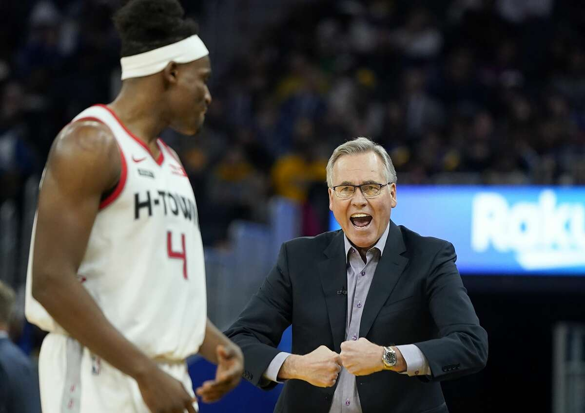 Houston Rockets coach Mike D'Antoni, right, talks with forward Danuel House Jr. during the first half of the team's NBA basketball game against the Golden State Warriors in San Francisco, Wednesday, Dec. 25, 2019. (AP Photo/Tony Avelar)
