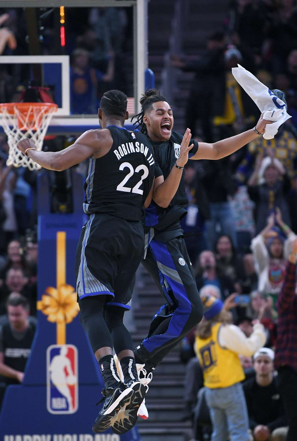 SAN FRANCISCO, CALIFORNIA - DECEMBER 25: Glenn Robinson III #22 and Jordan Poole #3 of the Golden State Warriors celebrates after Robinson III made a three-point shot against the Houston Rockets during the second half of an NBA basketball game at Chase Center on December 25, 2019 in San Francisco, California. NOTE TO USER: User expressly acknowledges and agrees that, by downloading and or using this photograph, User is consenting to the terms and conditions of the Getty Images License Agreement. (Photo by Thearon W. Henderson/Getty Images)